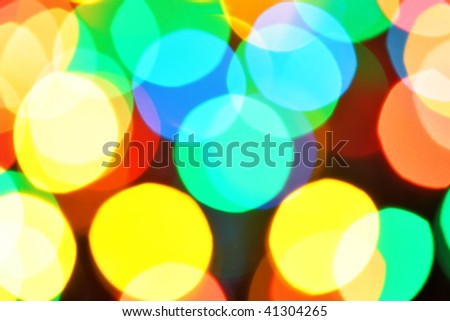 Colorful christmas lights out of focus and stars, may be used as background