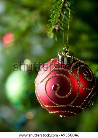 Colorful christmas ornaments hanging from christmas tree - stock photo