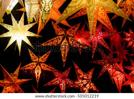 Colorful Christmas stars. A background of star lanterns