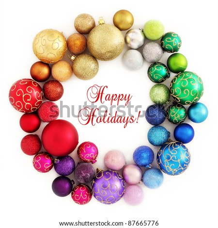 Colorful Christmas wreath decoration from rainbow color baubles on white background - stock photo