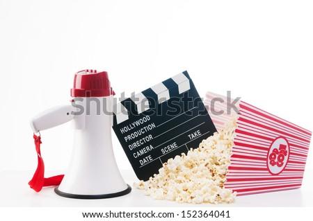 Colorful Cinema concept-pop corn,film reel,clapper board, - stock photo