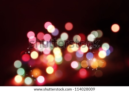 Colorful circles on red tone background - stock photo