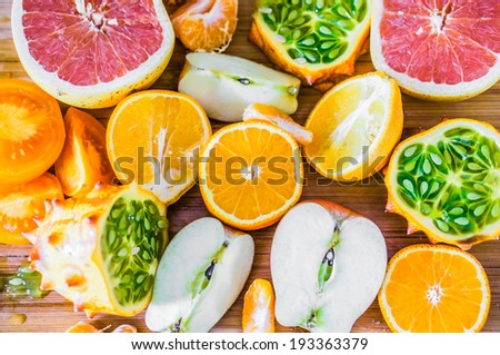 Colorful citrus fruits on rustic background