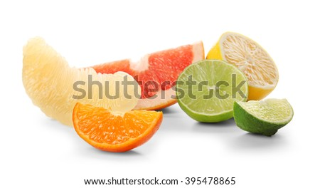 Colorful citrus slices and halves isolated on a white background, close up