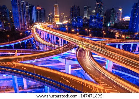 colorful city interchange overpass at night in shanghai,China - stock photo