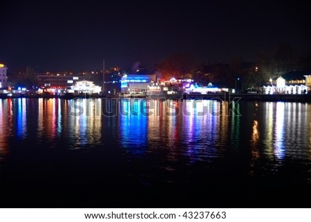 Colorful city lights with soft water reflection