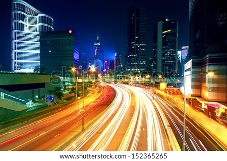 Colorful city night with lights of cars motion blurred in hong kong - stock photo