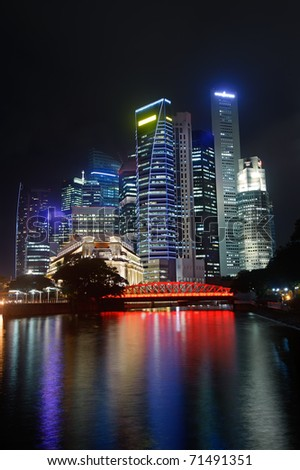 Colorful city night with skyscrapers near river in Singapore, Asia. - stock photo