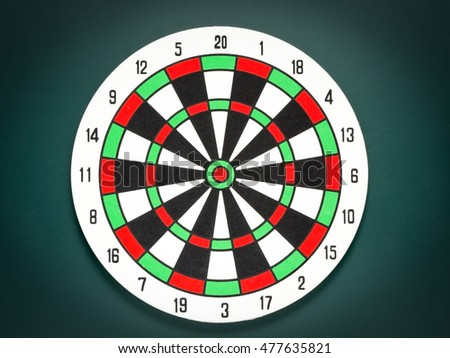 Colorful  Classic dart target board on black background.