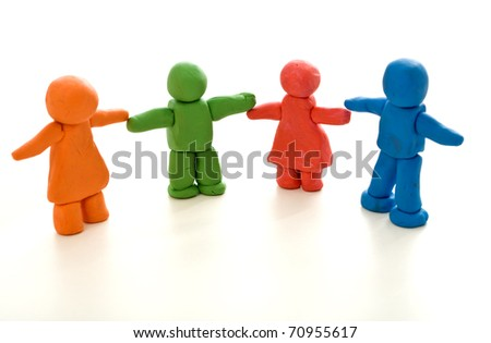 Colorful clay people on white - unity in diversity or family concept - stock photo