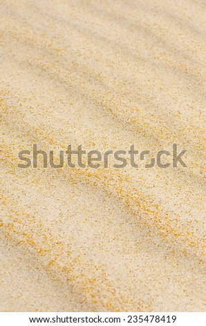 Colorful closeup detail of wavy and rippled lines and curves of remote sandy desert or beach dune, natural design backdrop, background or wallpaper. - stock photo