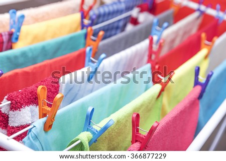 Colorful clothes hung out dries in the dryer. - stock photo