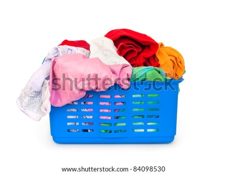 Colorful clothes in a laundry basket on white background - stock photo