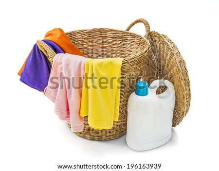 Colorful clothes in a laundry wooden basket on white background - stock photo