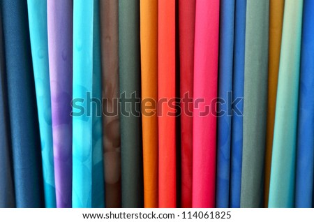 colorful clothes in lining. - stock photo