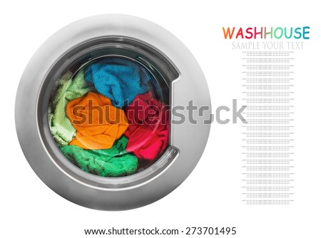 colorful clothes in the washing machine on a white background. focus on laundry. Text example - stock photo