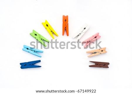 Colorful clothes pins isolated on a white background. - stock photo