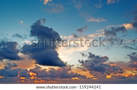 colorful clouds at dusk - stock photo