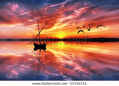 colorful clouds reflected in water - stock photo
