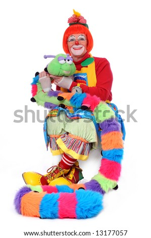 Colorful clown sitting with pet worm - stock photo