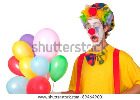 Colorful clown with balloons isolated on white background - stock photo