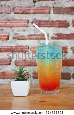 Colorful cocktail drink  , on wood table . - stock photo
