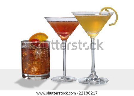 colorful cocktail drinks two Manhattans and a Side Car - stock photo
