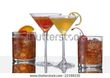colorful cocktail drinks, two Manhattans, and Old Fahion and a Side Car - stock photo