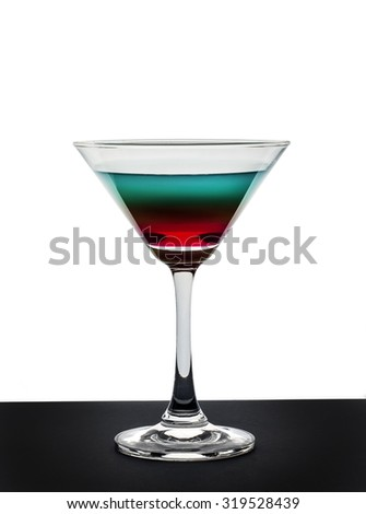 Colorful cocktail in martini glass