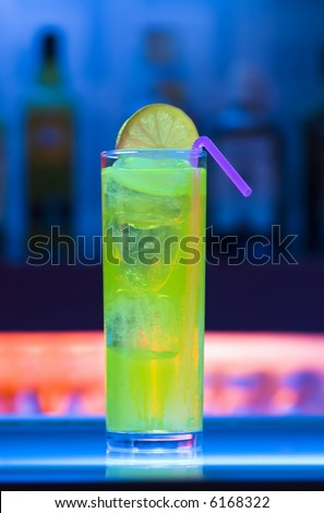 Colorful cocktail on a blue neon bar - stock photo