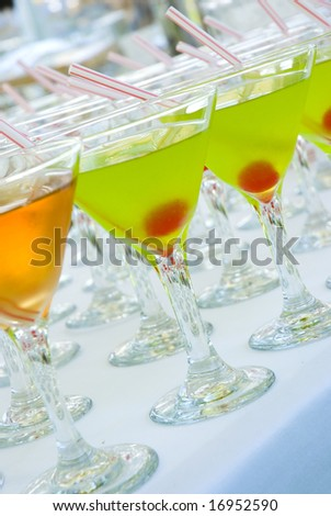 Colorful cocktails in a bar table - stock photo
