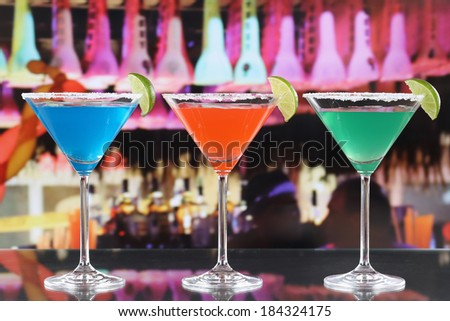 Colorful cocktails in Martini glasses in a bar or a party - stock photo
