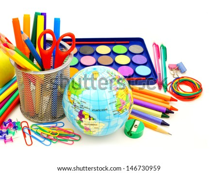 Colorful collection of various school supplies over white - stock photo