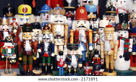 Colorful collection of wooden Christmas nutcrackers, old and new. - stock photo