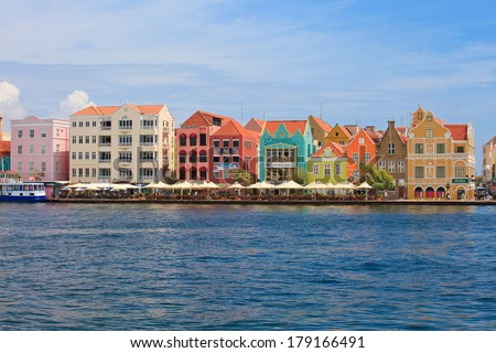Colorful colonial houses in Willemstad, Capital of Curacao in the Caribbean. Downtown Willemstad is a UNESCO World Heritage Site.  - stock photo