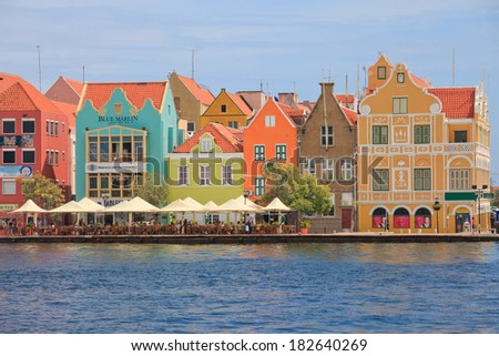 Colorful colonial houses in Willemstad, Capital of Curacao in the Caribbean. Downtown Willemstad is a UNESCO World Heritage Site  - stock photo