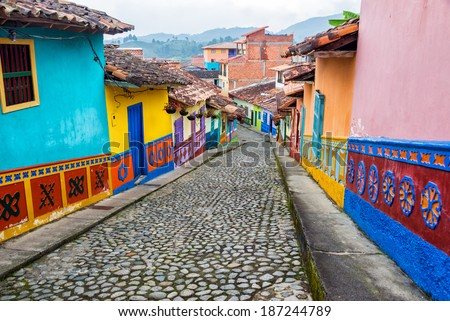 Colorful colonial houses on a cobblestone street in Guatape, Antioquia in Colombia - stock photo