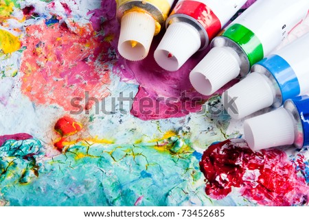 colorful color mixing palette of different color tubes - stock photo