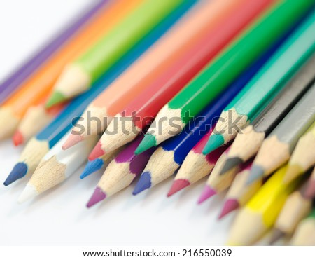 Colorful colored pencil closeup macro on white background
