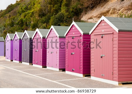 Colorful, colourful beach huts at an English beach resort. - stock photo