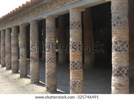 Colorful columns in Villa dei misteri in Pompeii, Italy - stock photo