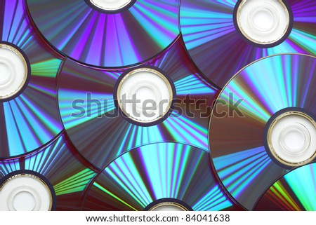 Colorful compact disc, dvd or cd rom - stock photo