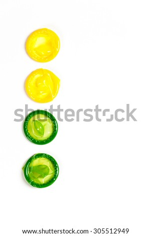 Colorful condom on white background - stock photo