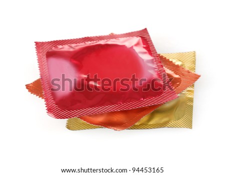 Colorful condoms isolated on white - stock photo