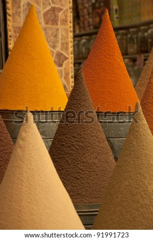 Colorful cones of spices in the Souks of Marrakech - stock photo
