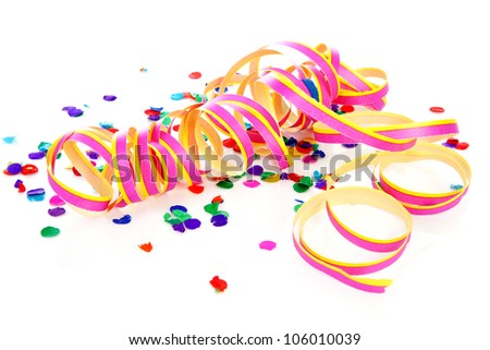Colorful confetti and party streamer over white background - stock photo