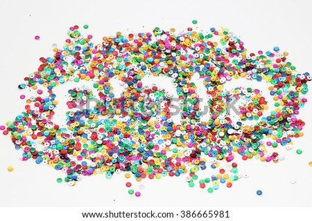 Colorful confetti forming the word Purim in Hebrew. The confetti symbolizes the fun and celebration of Purim holiday.