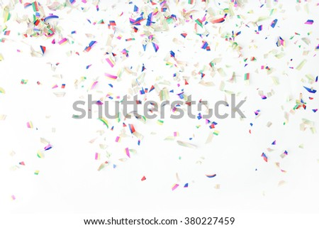 Colorful confetti on white background. Holiday or party background - stock photo