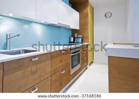 colorful contemporary kitchen with modern electric appliances - stock photo