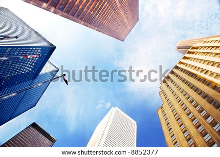 Colorful corporate buildings in city business center - stock photo